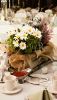 Flower centerpiece with daisies, white and pink flowers